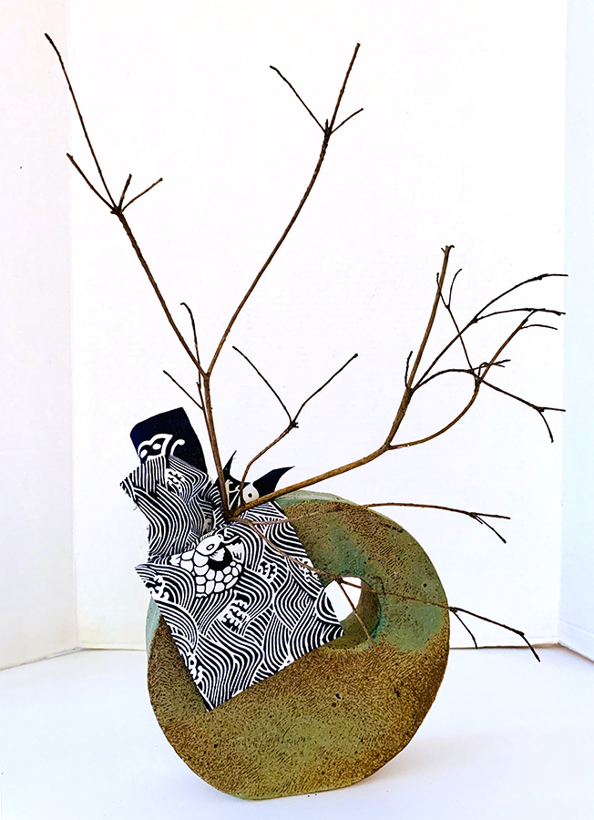 Margaret - Simple dried branch set with Japanese Shibori  fabric in a self made container makes for an elegant arrangement